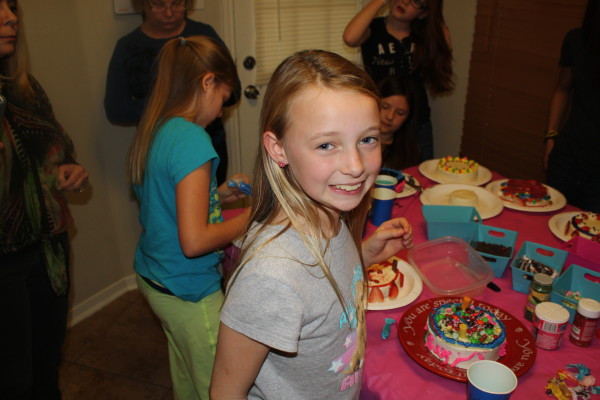 My granddaughter decorating cake