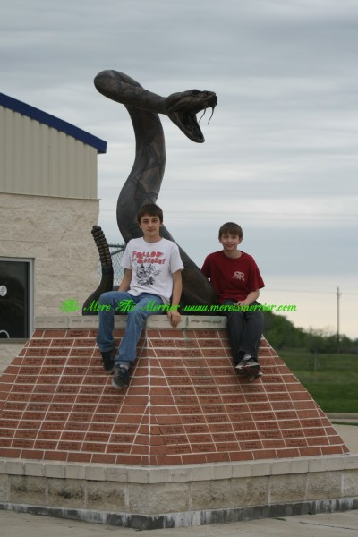 Boys with the Navasota High School Mascot Statue