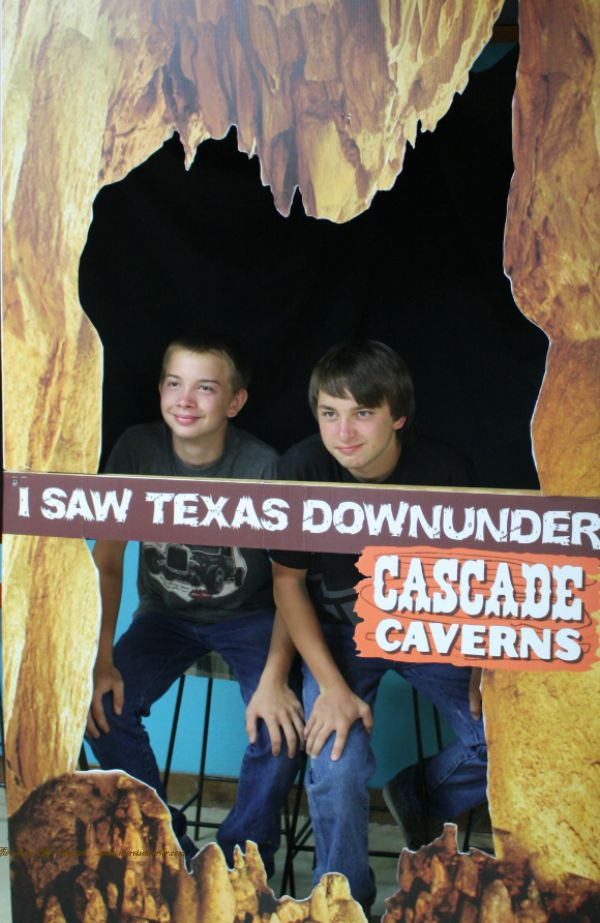The boys in the photo opp at Cascade Caverns