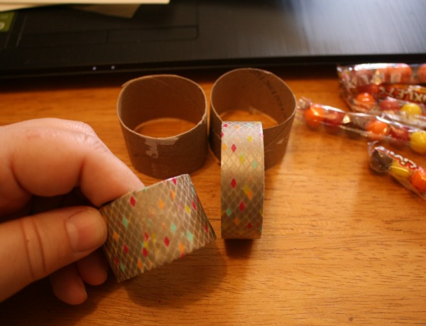 Wrap the toilet paper ring with washi tape.