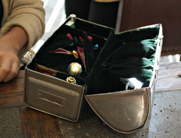 I love this very organized vintage lunch box Kayleen carries as a purse!
