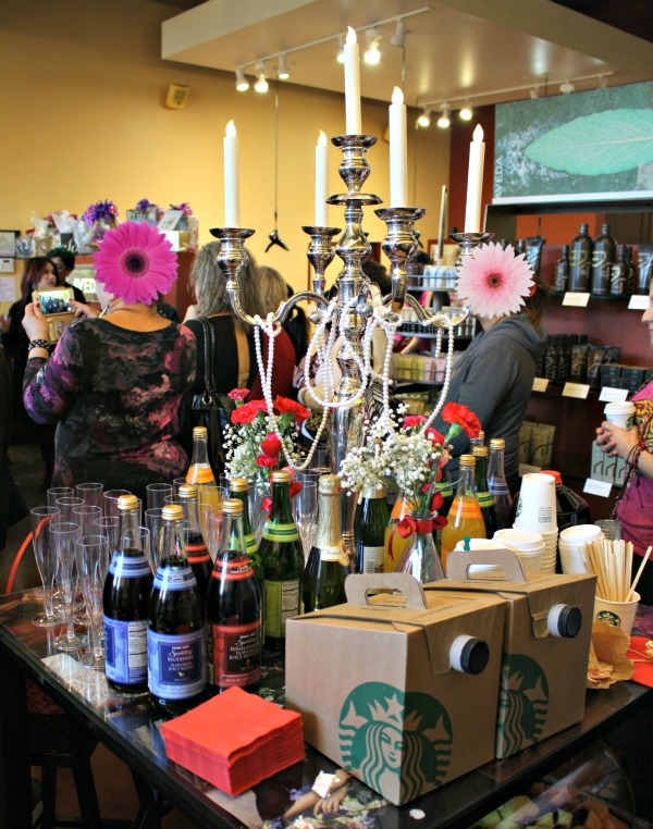 A beautiful beverage table full of sparkling fruit juices and coffee at A Night of Beauty