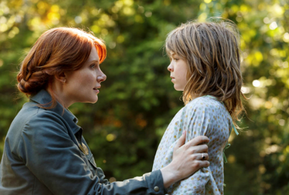 Oakes Fegley and Bryce Dallas Howard in Pete's Dragon