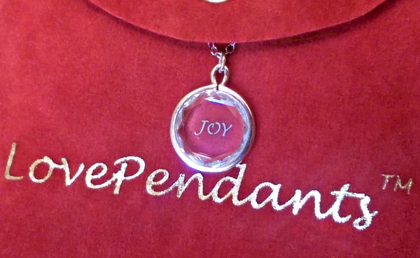 LovePendants are made with a specially cut gemstone and enameled engraving.