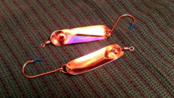 The PEETZ Hookum Spoon lure has shiny reflective stickers on one side.