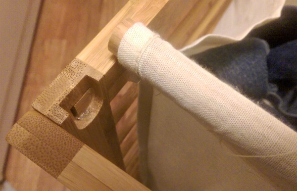 These rods slip out so the bamboo  laundry hamper can be washed.