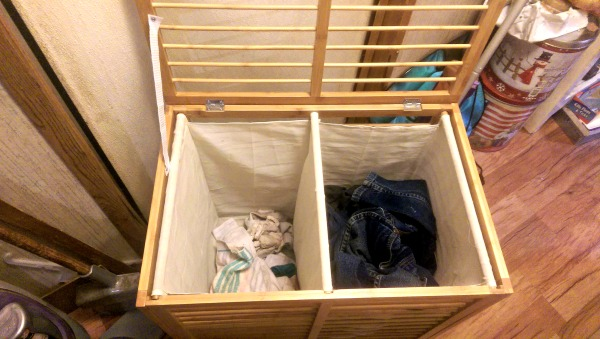 This ToiletTree Bamboo laundry hamper has a side for lights and a side for darks.