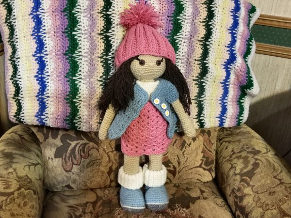 This little doll will be in DancingRoosterFarm etsy shop as soon as I add a few more details!