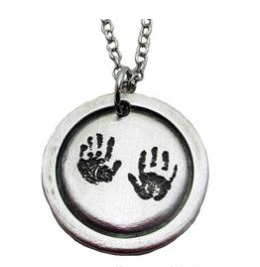 An example of a Handprint Pendant from Lauren Nicole Gifts. Grandparents would love this!