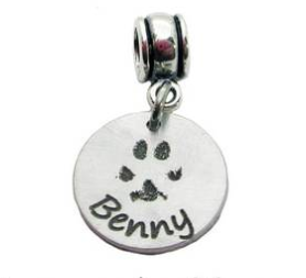 An example of a Pawprint Charm from Lauren Nicole Gifts.