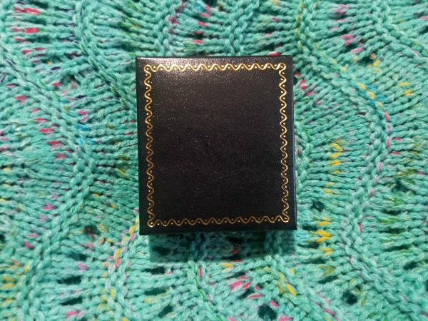 There is a beautiful locket from PicturesOnGold.com in this box!