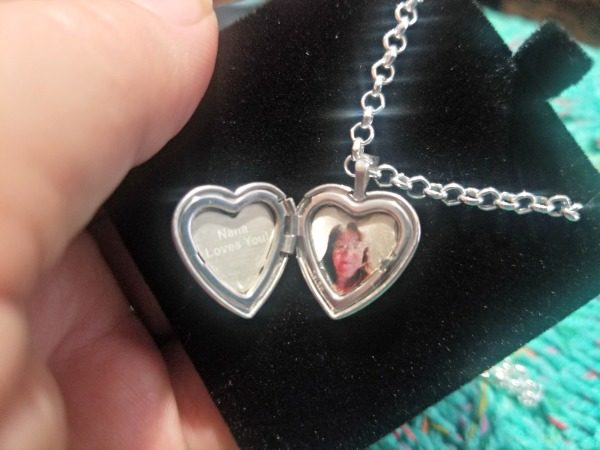 The picture is color engraved right onto the locket!